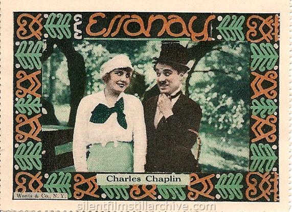 Edna Purviance and Charlie Chaplin in IN THE PARK (1915) collector stamp from Wentz & Co.