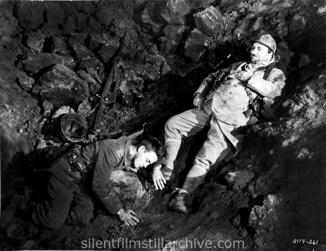 Lew Ayres and Raymond Griffith in ALL QUIET ON THE WESTERN FRONT (1931). Paul stabs the French soldier who falls into the shall-hole where he has taken cover.