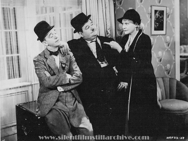 Stan Laurel, Oliver Hardy and Minna Gombell in BLOCK-HEADS (1938)