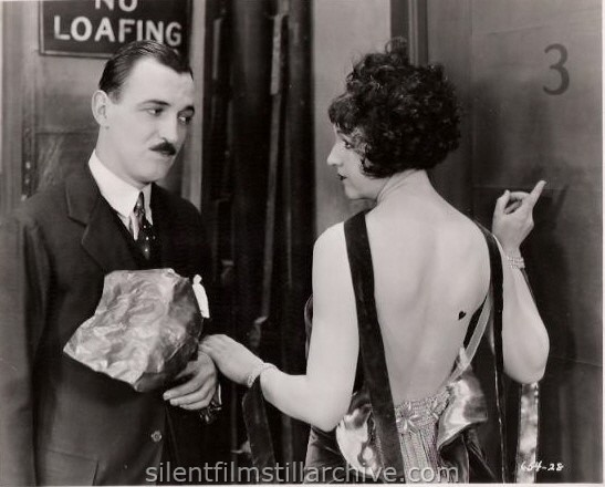 Raymond Griffith and Julia Faye in CHANGING HUSBANDS (1924)