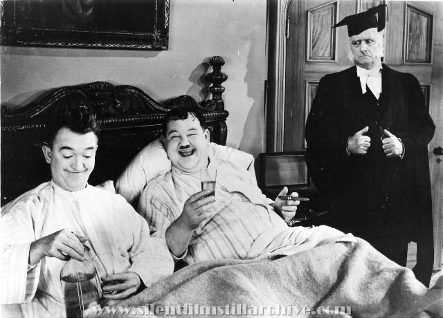 Stan Laurel and Oliver Hardy and Wilfred Lucas in A CHUMP AT OXFORD (1939)