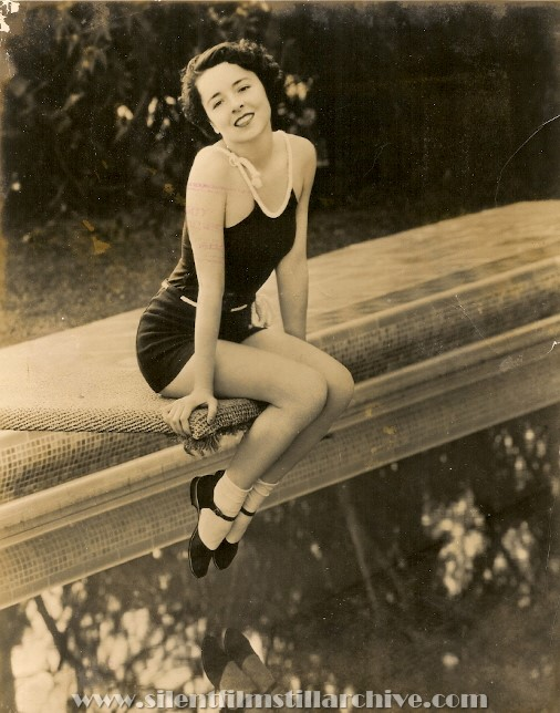 Press photo of Colleen Moore at her pool in 1934.