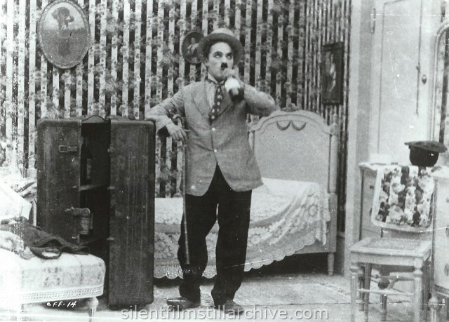 Charlie Chaplin in THE CURE (1917).