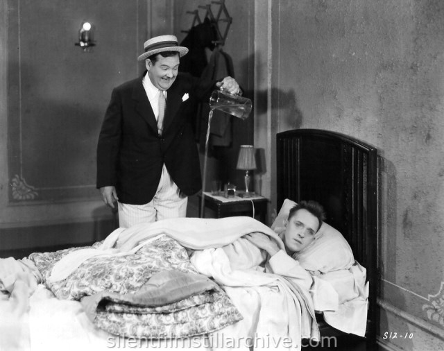 Oliver Hardy and Stan Laurel in EARLY TO BED (1928)