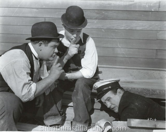 Oliver Hardy, Stan Laurel, and Edgar Kennedy in THE FINISHING TOUCH (1928)