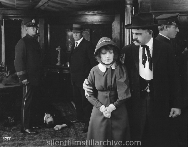 Charles West, Fanny Ward and Ronald Bradbury in A GUTTER MAGDALENE (1916).