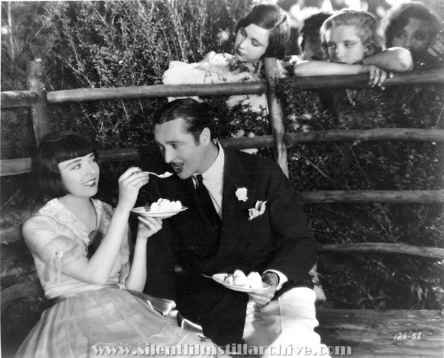 Colleen Moore and Edmund Lowe in HAPPINESS AHEAD (1928)