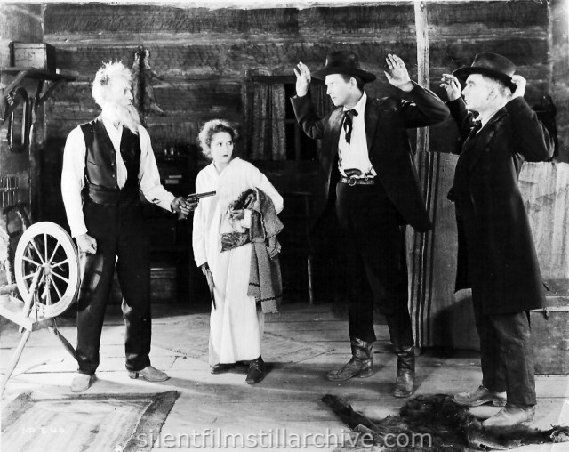 Fred Huntley, Mary Pickford, Allan Sears, and Sam De Grasse in HEART O' THE HILLS (1919)