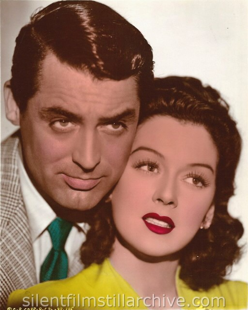 Cary Grant and Rosalind Russell in HIS GIRL FRIDAY (1940). A vintage colorized still.