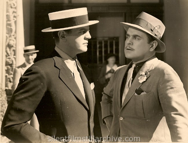 Chester Morris and Leo Carrillo in I PROMISE TO PAY (1937).