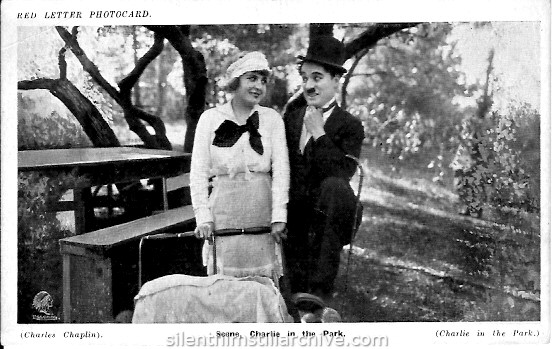 Edna Purviance and Charlie Chaplin in IN THE PARK (1915) Red Letter Photocard