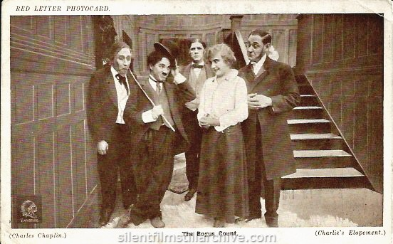 Paddy McGuire, Charlie Chaplin, Lloyd Bacon, Edna Purviance and Fred Goodwins in A JITNEY ELOPEMENT (1915). Red Letter Photocard