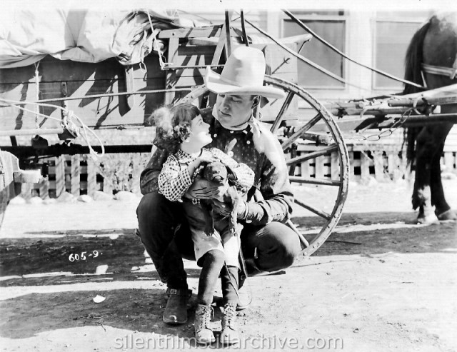 Roy Stewart and Frankie Lee in THE BOSS OF THE LAZY Y (1918)