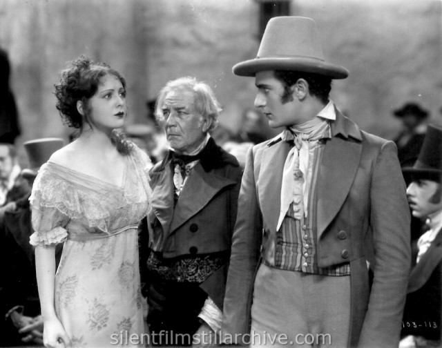 Billie Dove, Emile Chautard and Gilbert Roland in THE LOVE MART (1927)