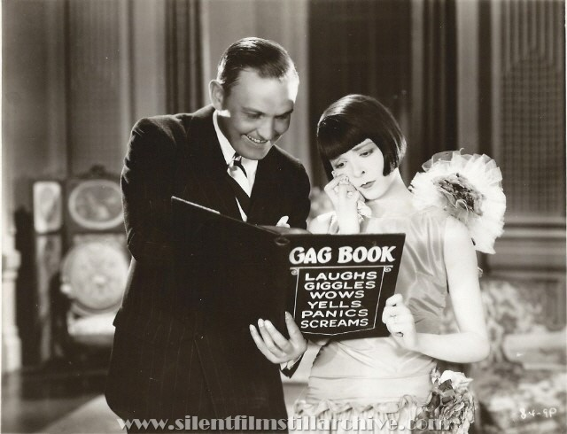 Director Millard Webb and Colleen Moore in a publicity pose for NAUGHTY BUT NICE (1927)