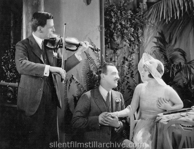 Violinist Albert Spalding, Raymond Griffith and Vera Reynolds in THE NIGHT CLUB (1925)