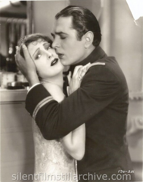 Billie Dove and Donald Reed in THE NIGHT WATCH (1928).