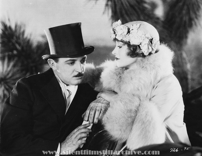 Raymond Griffith and Betty Compson in PATHS TO PARADISE (1926)