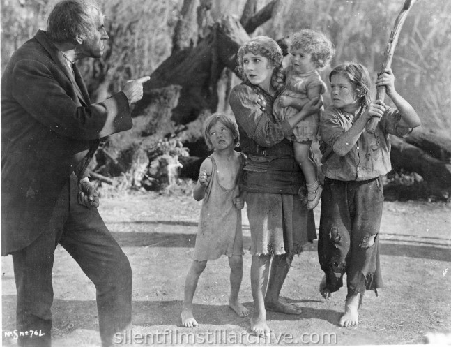 Gustav von Seyffertitz, Mary Pickford (holding baby Mary Louise Miller), and Billy Butts in SPARROWS (1926)