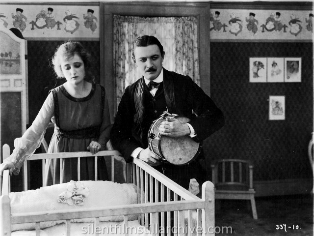 Rae Godfrey and Raymond Griffith in THEIR NEIGHBOR'S BABY (1918)