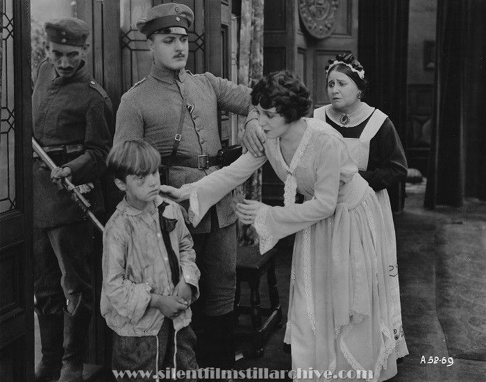 Frank Butterworth, and Lillign Leighton in TILL I COME BACK TO YOU (1918)