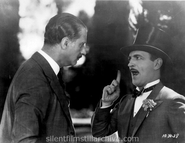 Pierre de Ramey and Raymond Griffith in TIME TO LOVE(1927)