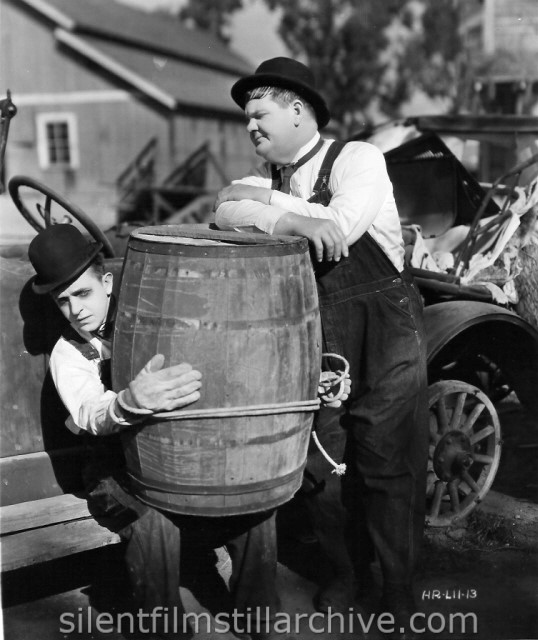 Stan Laurel and Oliver Hardy in TOWED IN A HOLE (1932)