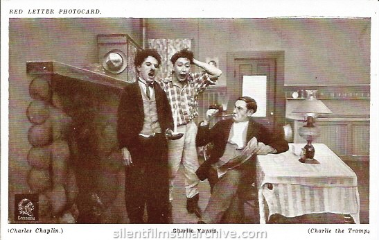 Red Letter Photocard of Charlie Chaplin, Ernest VanPelt and Paddy McGuire in THE TRAMP (1915)