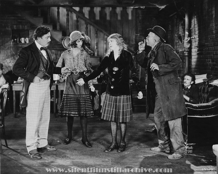 Twinkletoes, A First National Production -- Twinkletoes asks Roseleaf where her father is while Lilac looks on and Hank signals Roseleaf not to tell. Warner Oland, Julanne Johnston, Colleen Moore, and Lucien Littlefield